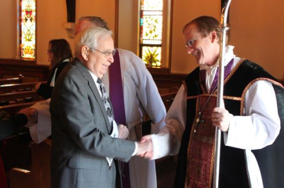 Bishop Dorsey W.M. McConnell greets St. Stephen's parishioner and usher Marshall Swauger.